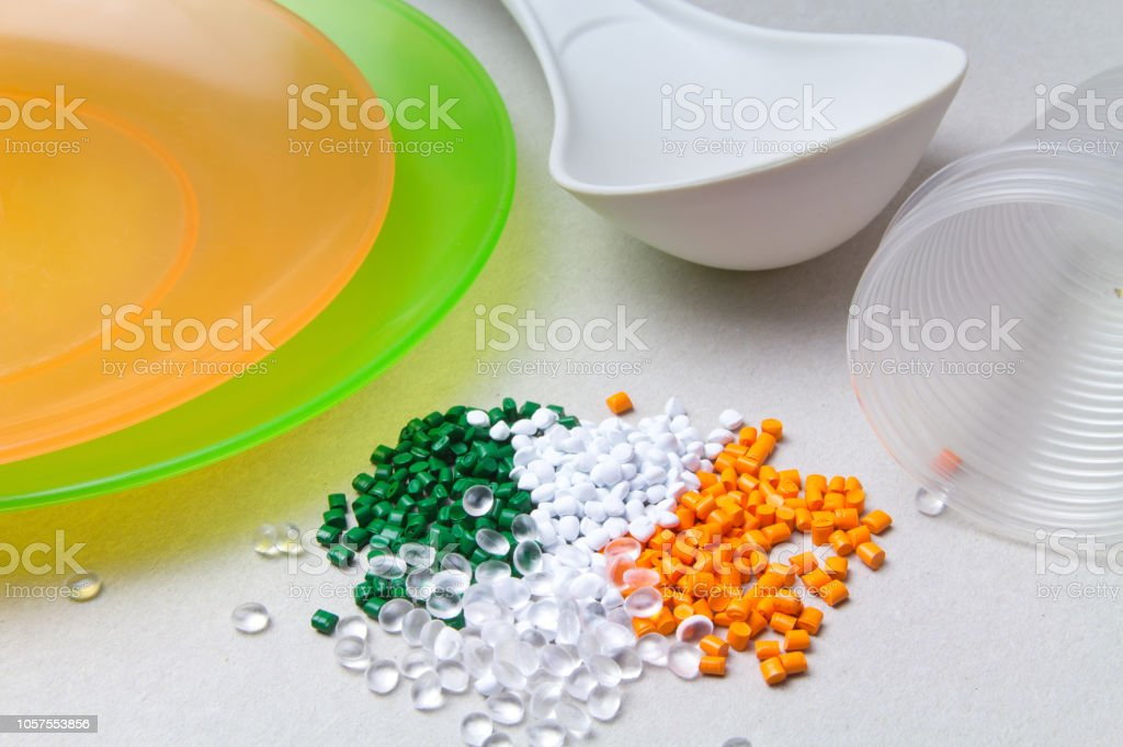 Plastic disposable tableware and Plastic Raw material. BPA FREE concept stock photo
