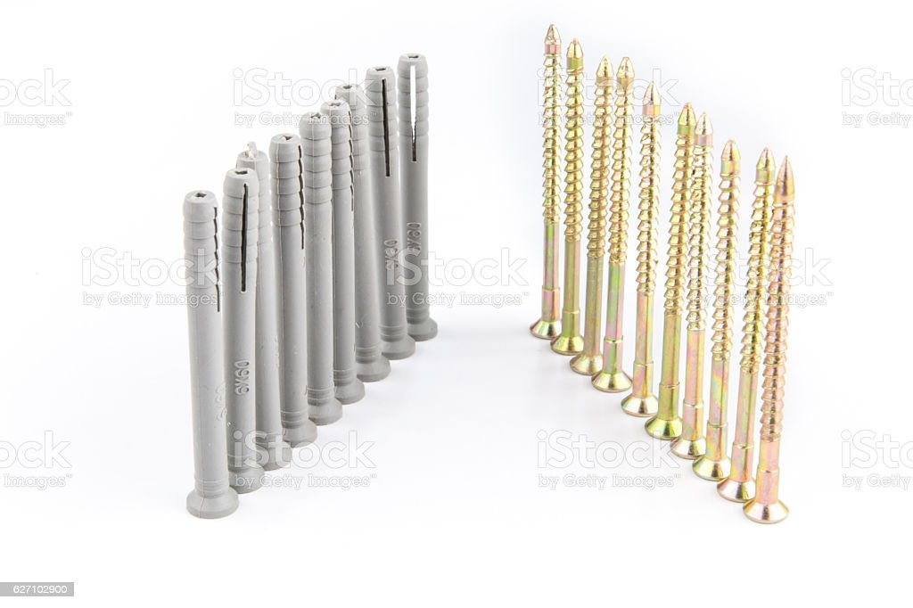 Plastic dowel or wall plugs pin with screws for bricks stock photo