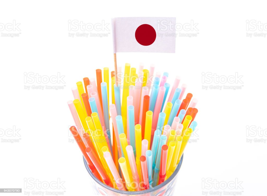 Plastic drinking straw concept with flag of Japan stock photo