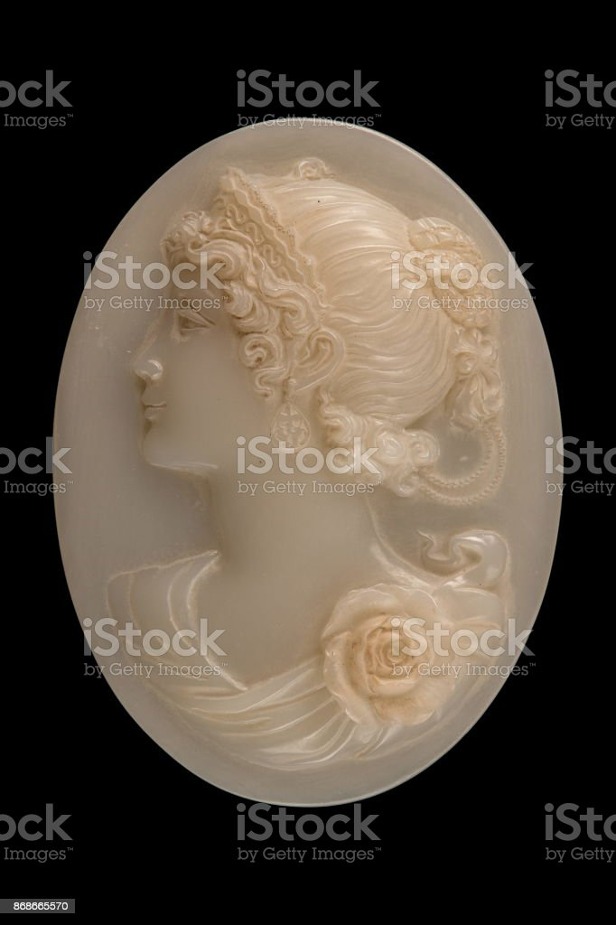 plastic face in a medallion on a black background stock photo