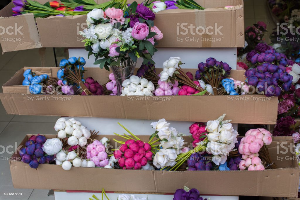 Plastic fake flowers colourful flowers stock photo