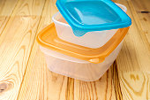 Plastic food containers on a wooden table