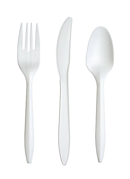 Plastic fork, knife, and spoon stock photo