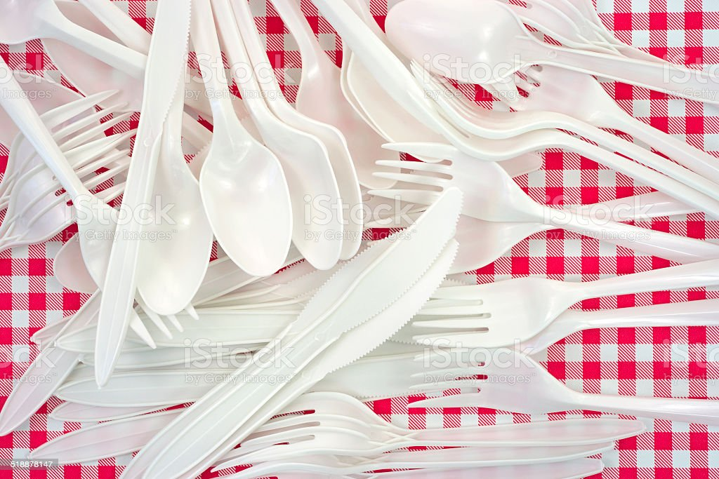 Plastic forks knives spoons stock photo