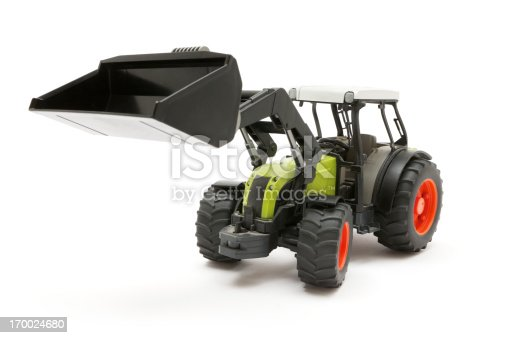 Toy bulldozer isolated on a white background. Shallow depth of field.