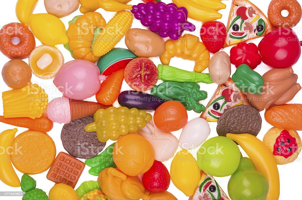 Plastic game, fake varied vegetables and fruits. background stock photo
