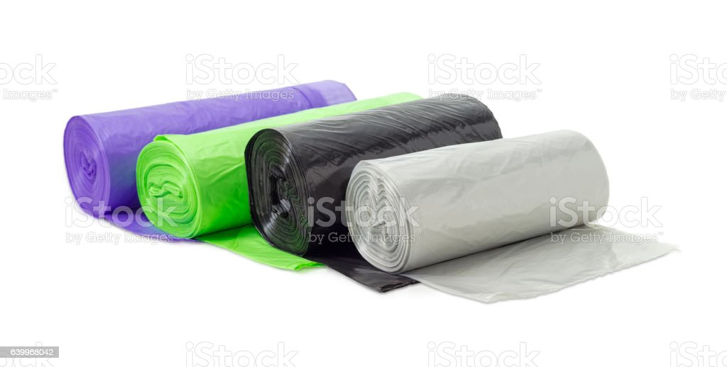 Plastic garbage bags in rolls of different sizes and colors - foto de acervo