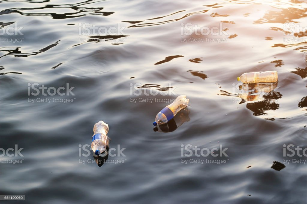 Plastic garbage in the river on sunset, pollution and environment concept – zdjęcie