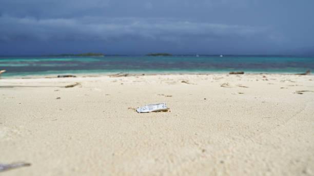 Plastic garbage of COVID19 on uninhabited island of archipelago San Blas stock photo