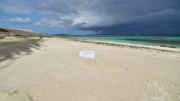 Plastic garbage Test of COVID19 is already on uninhabited island stock photo