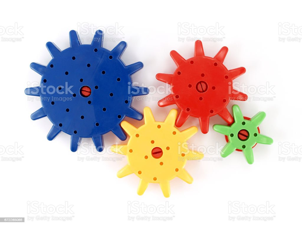 plastic gear isolated on white background stock photo