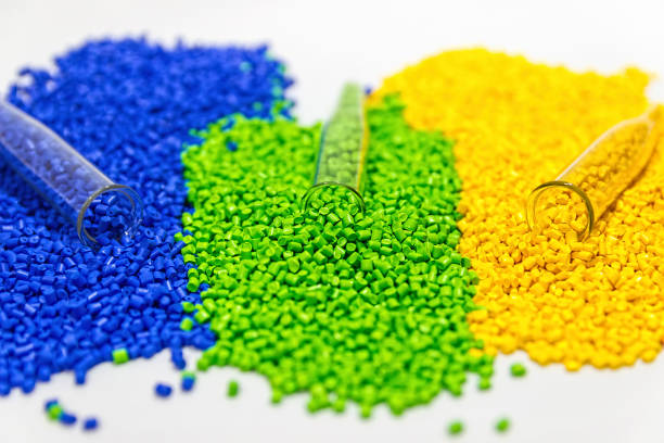 Plastic granules. Polymeric dye. Colorant pellets. stock photo