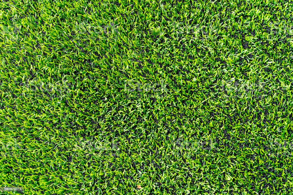 Plastic grass with rubber floor for Indoor sport courtyard stock photo