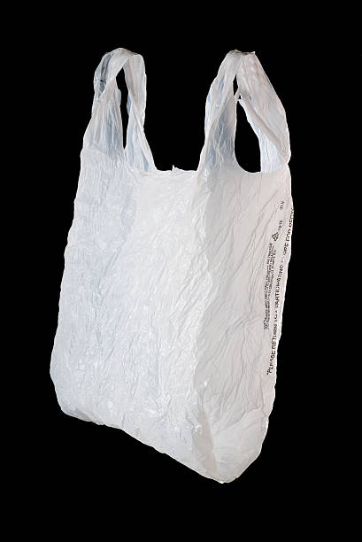 Plastic Grocery Bag White plastic grocery bag shot on black. plastic bag stock pictures, royalty-free photos & images