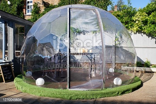 istock Plastic igloo dome tent used to dine outside pub during the Coronavirus (Covid-19) pandemic 1270045834