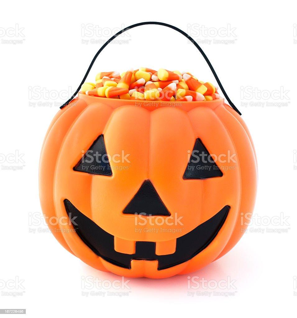 Plastic jack o lantern full of Halloween candy stock photo