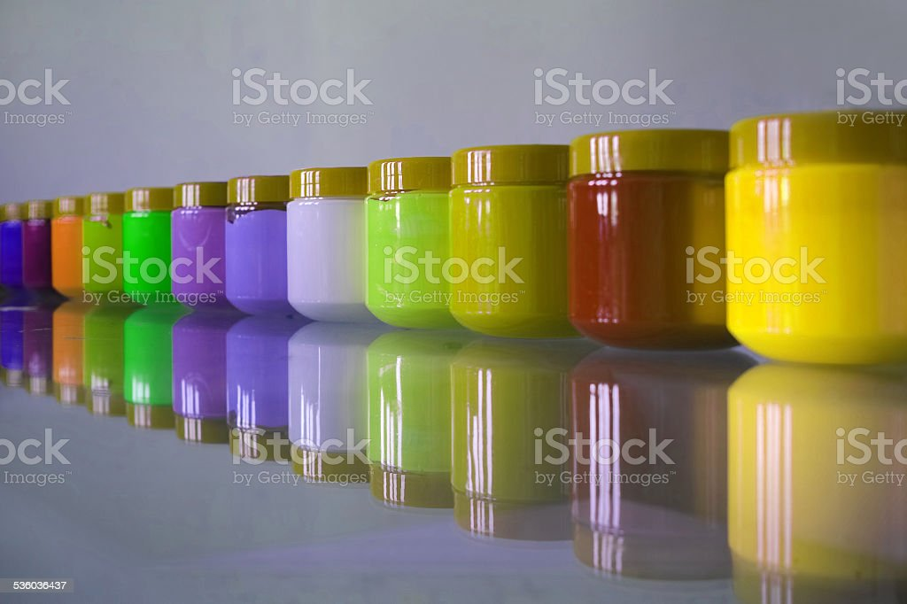 Plastic Jars of Acrylic Ordered in Line stock photo