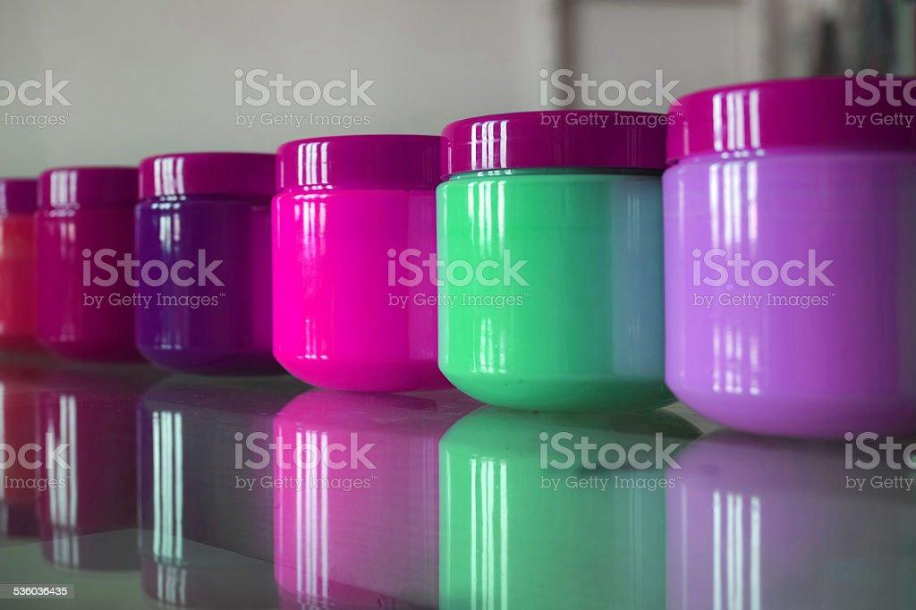 Plastic Jars of Acrylic Purple Shades And Green stock photo