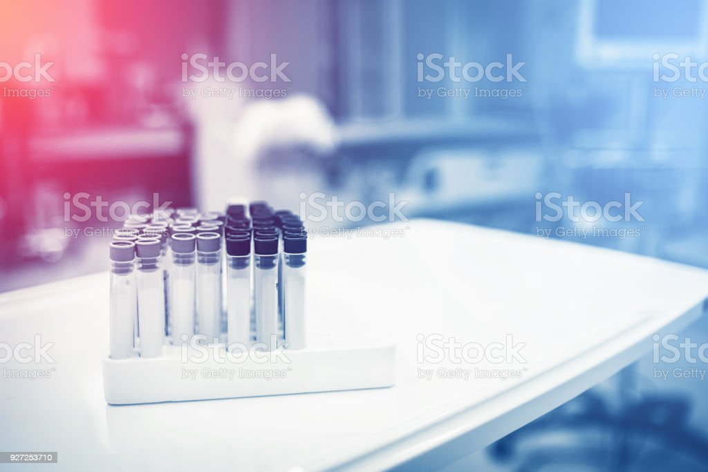 plastic laboratory tubes on a bench with filter color tone effect stock photo