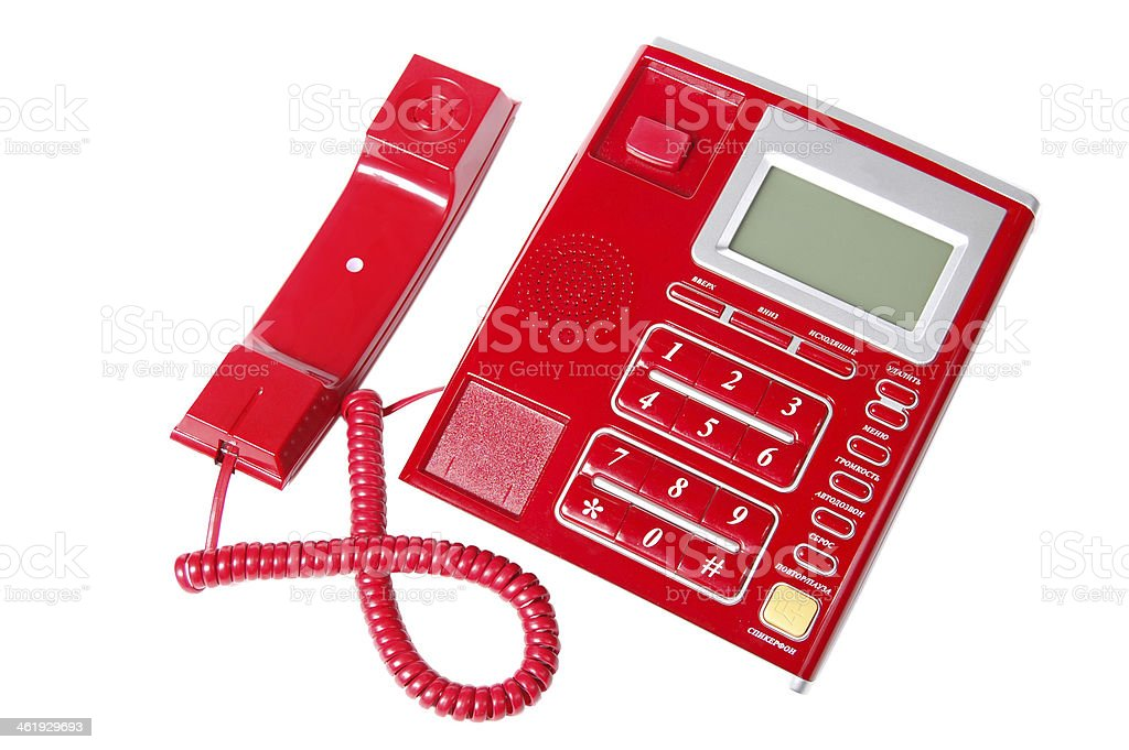 Plastic landline phone with buttons isolated on a white background. stock photo