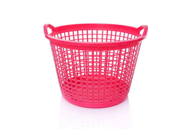Plastic laundry basket. Plastic laundry basket. Isolated on white background. laundry basket stock pictures, royalty-free photos & images