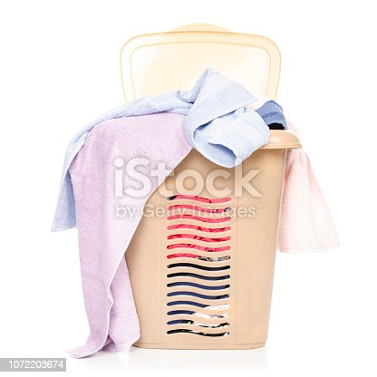 460589747 istock photo Plastic laundry basket with clothing and towels 1072203674