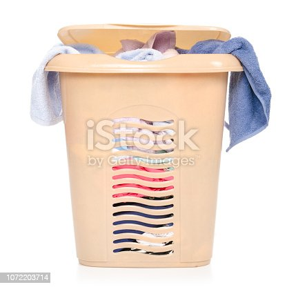 460589747 istock photo Plastic laundry basket with clothing and towels 1072203714
