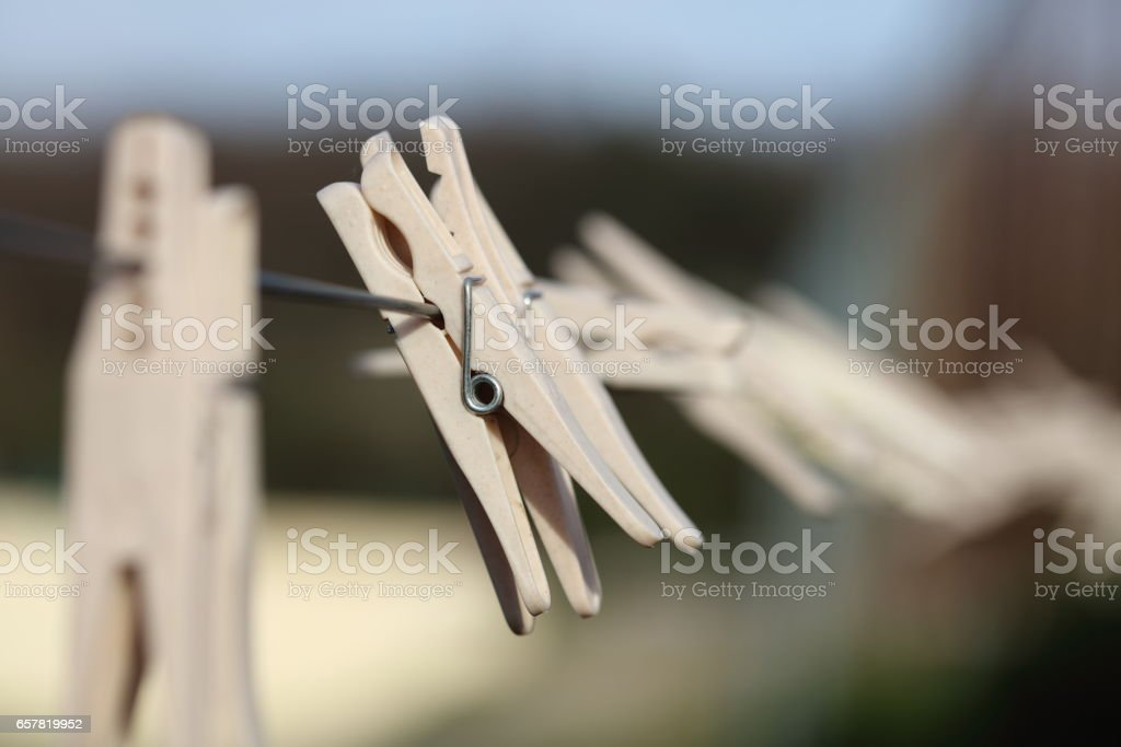 Plastic Linen Clothespins Closeup Hanging On The Clothesline Wire