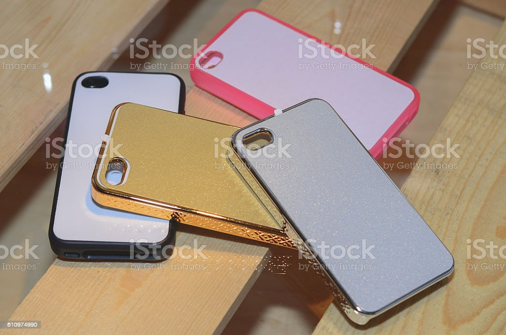 plastic mobile phone cases on a wood background stock photo