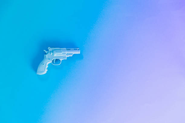 Plastic painted blue gun stock photo