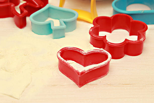 Plastic pastry cutters Colorful plastic pastry cutters on white table cookie cutter stock pictures, royalty-free photos & images