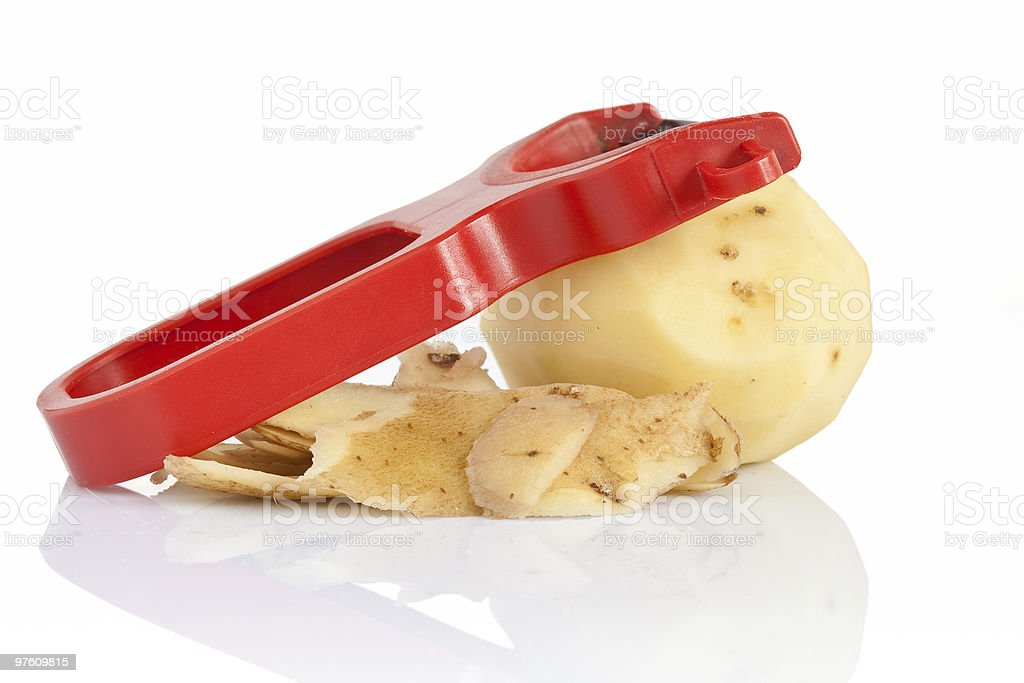 plastic peeler with potato royaltyfri bildbanksbilder