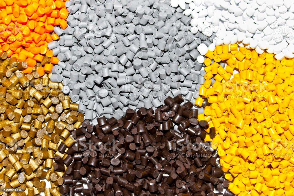 Plastic pellets. Polymeric dye.  Colorant for plastics in the granules. Plastic color resin closeup stock photo