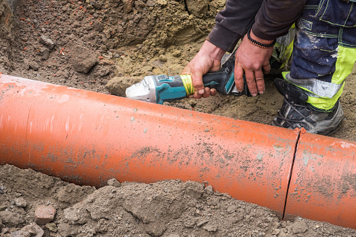 a plastic pipe is being cut in the well with a grinding tool