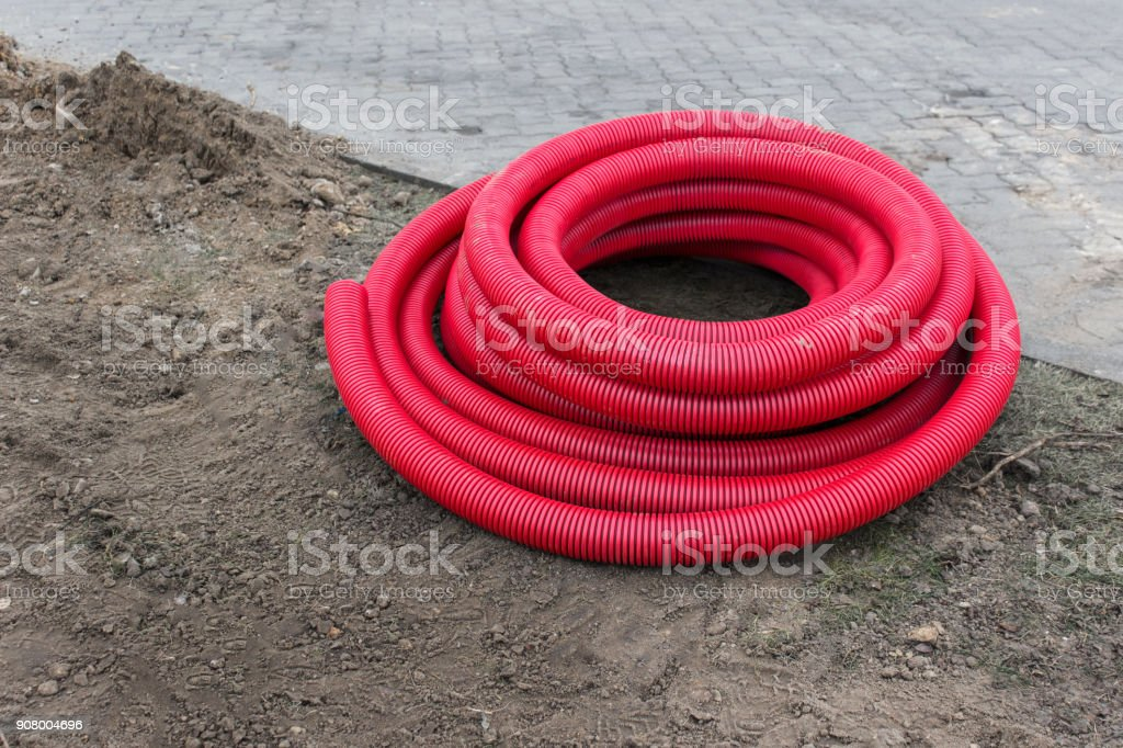 Plastic pipes on the ground stock photo