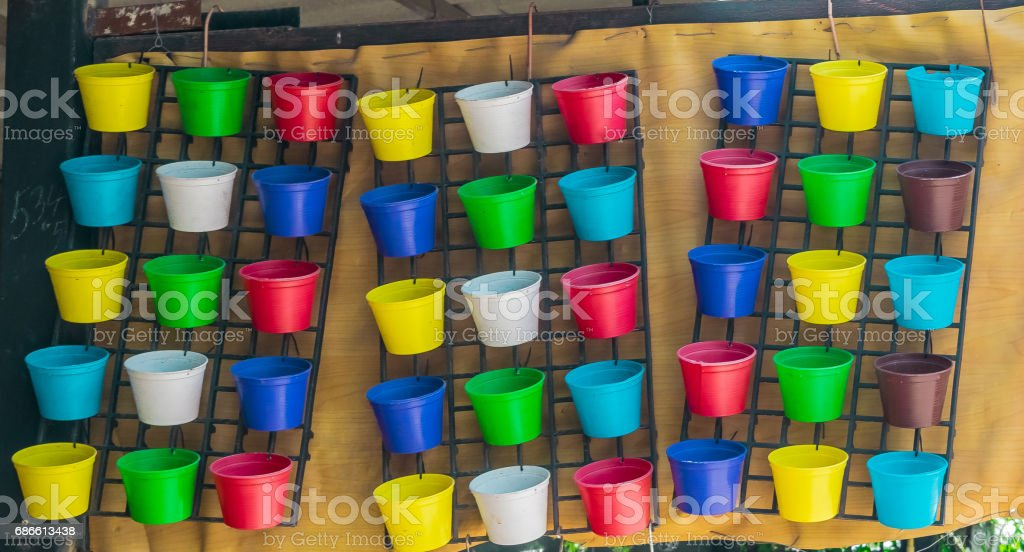 Plastic plant pots in many colors royalty-free stock photo