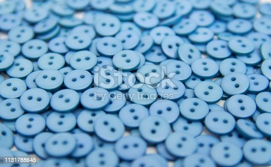 plastic plastic buttons pellets scattered on a white background