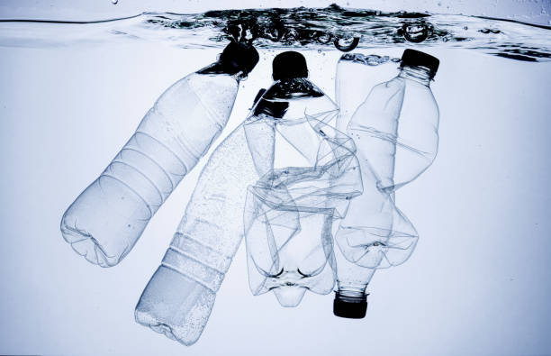 plastic pollution concept - ocean plastic stock pictures, royalty-free photos & images