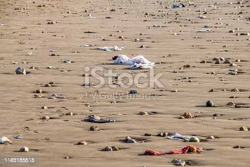 Plastic pollution with bags washed up on beach in Agadir, Morocco