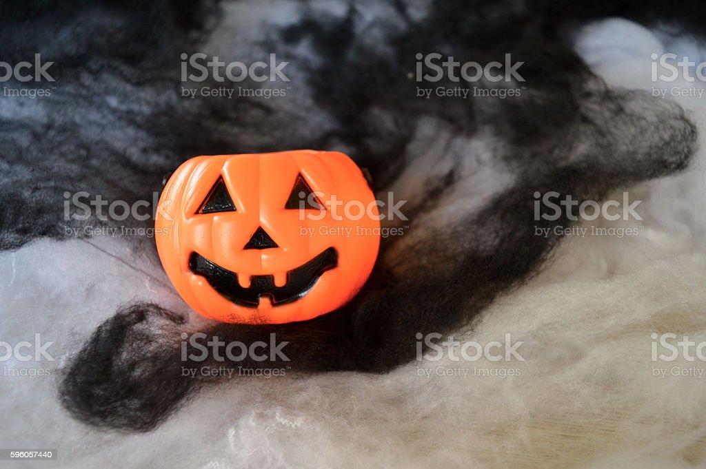 Plastic pumpkin buckets on black and white smoke background royalty-free stock photo