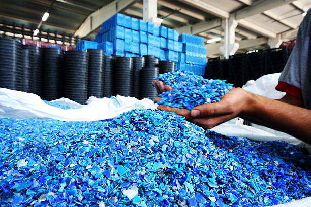 Plastic Resin pellets in holding hands stock photo