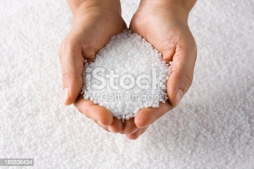Plastic White Round Resin Pellets in a Holding Hand