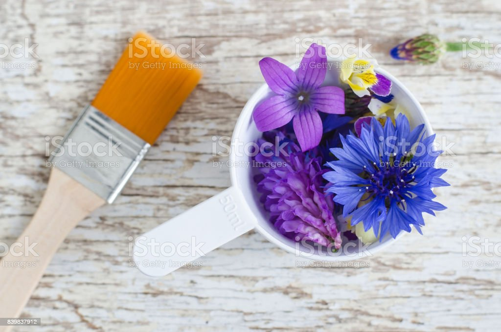 Plastic Scoop With Various Field Flowers And Cosmetic Brush