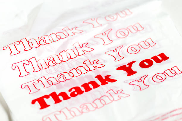 teşekkür ile plastik alışveriş çantaları - thank you background stok fotoğraflar ve resimler