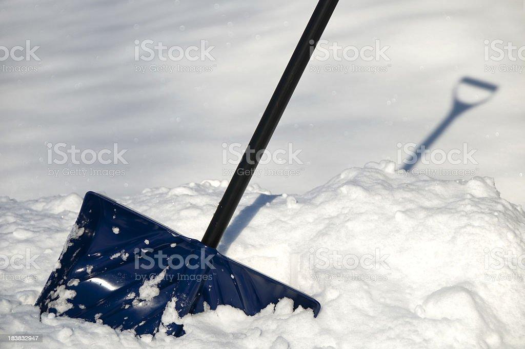 Plastic Shovel in Freshly Fallen Snow stock photo