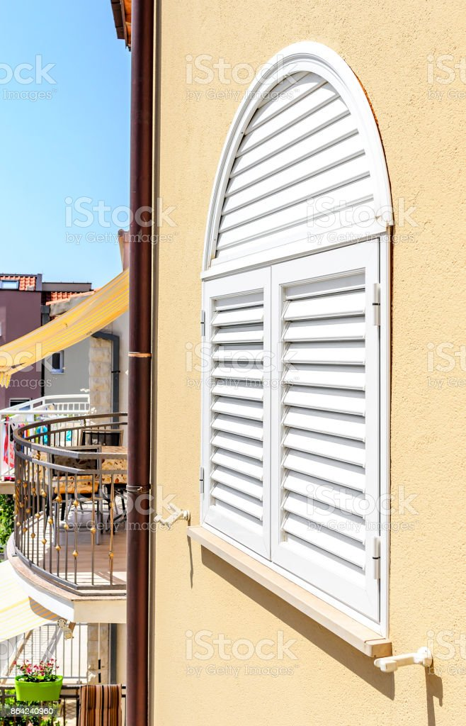 Plastic shutters on the window. royalty-free stock photo