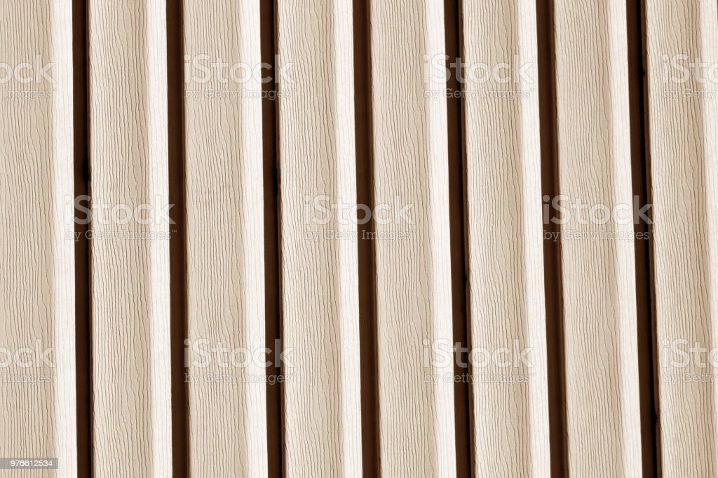 Plastic siding wall texture in brown tone. stock photo