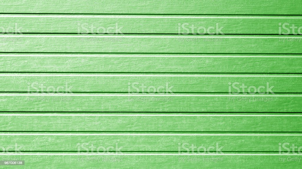 Plastic siding wall texture in green color. stock photo