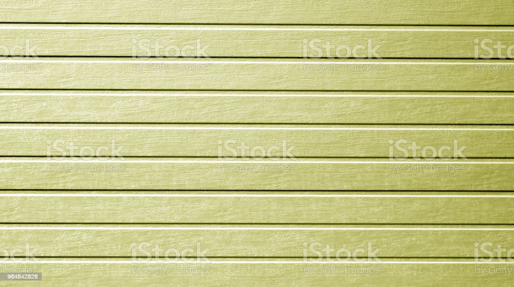Plastic siding wall texture in yellow color. royalty-free stock photo