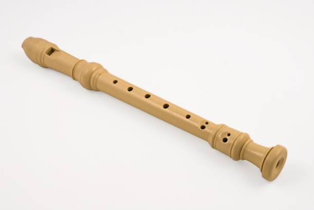 plastic soprano flute on a white background - recorder stock photos and pictures